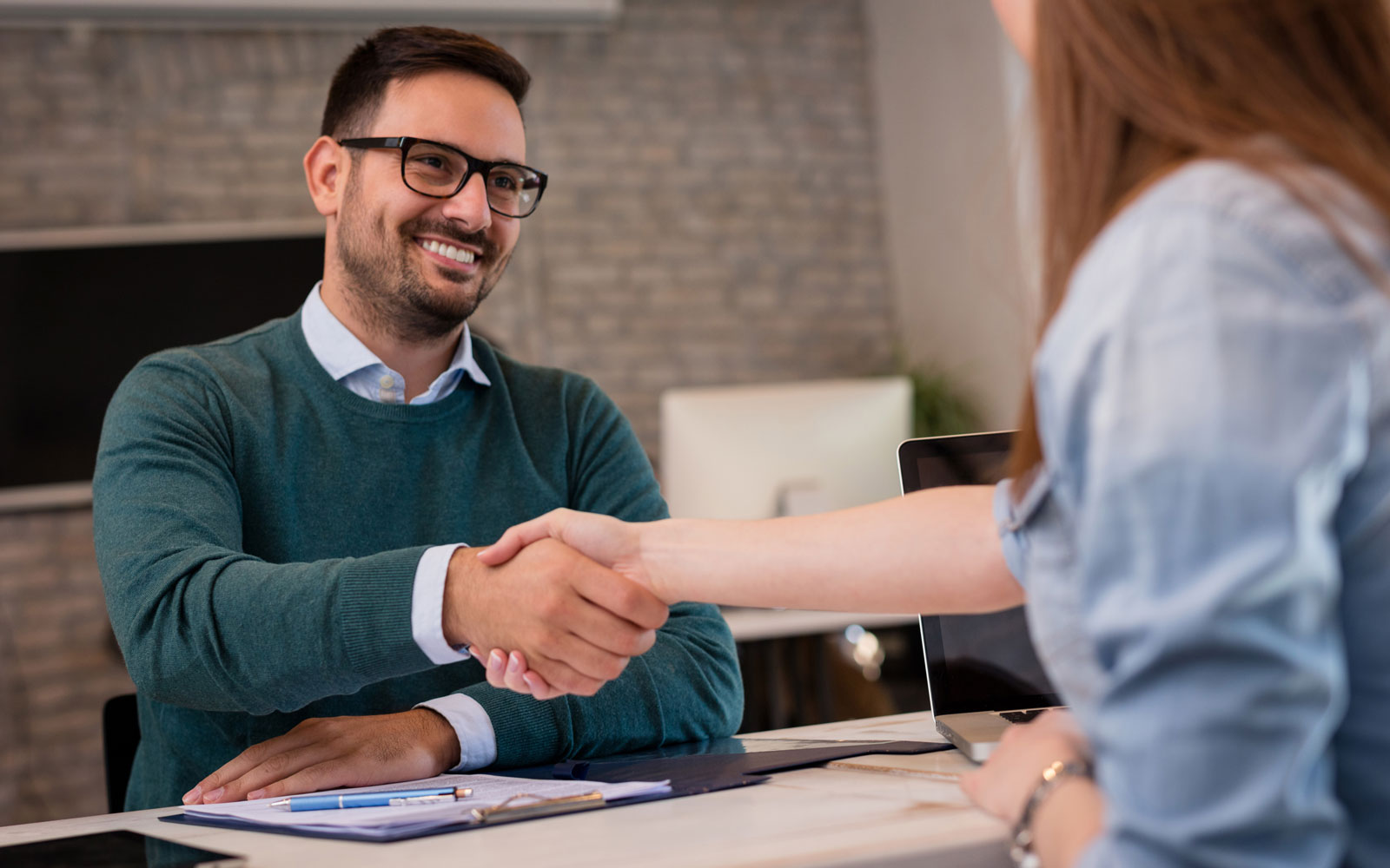 Professional man shaking hands newly hired employee