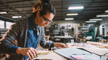 Woman in a workshop building construction model