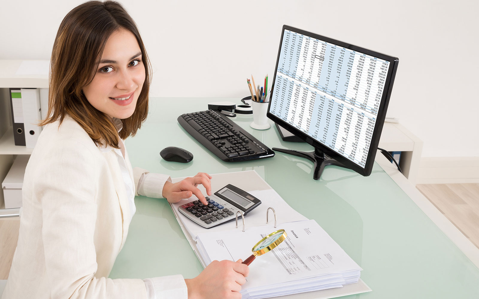 Accountant reviewing numbers at her desk