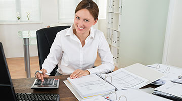 Accountant calculating numbers at her desk