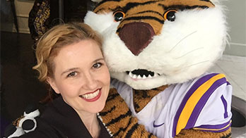 Dr. Sasha Thackaberry with Mike the Tiger.