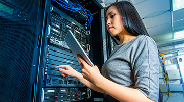 Woman working on IT servers