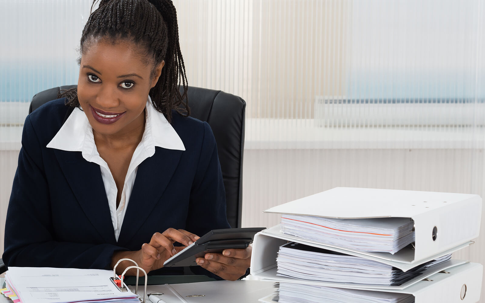 Accountant working at her desk