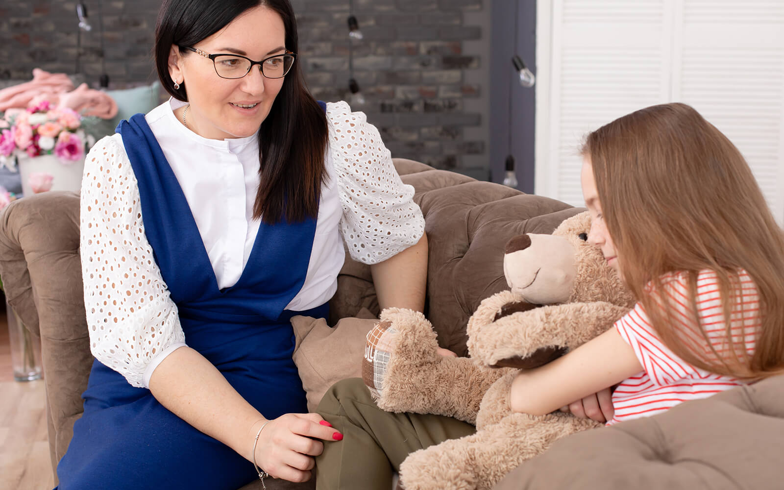 Counselor speaking with a child
