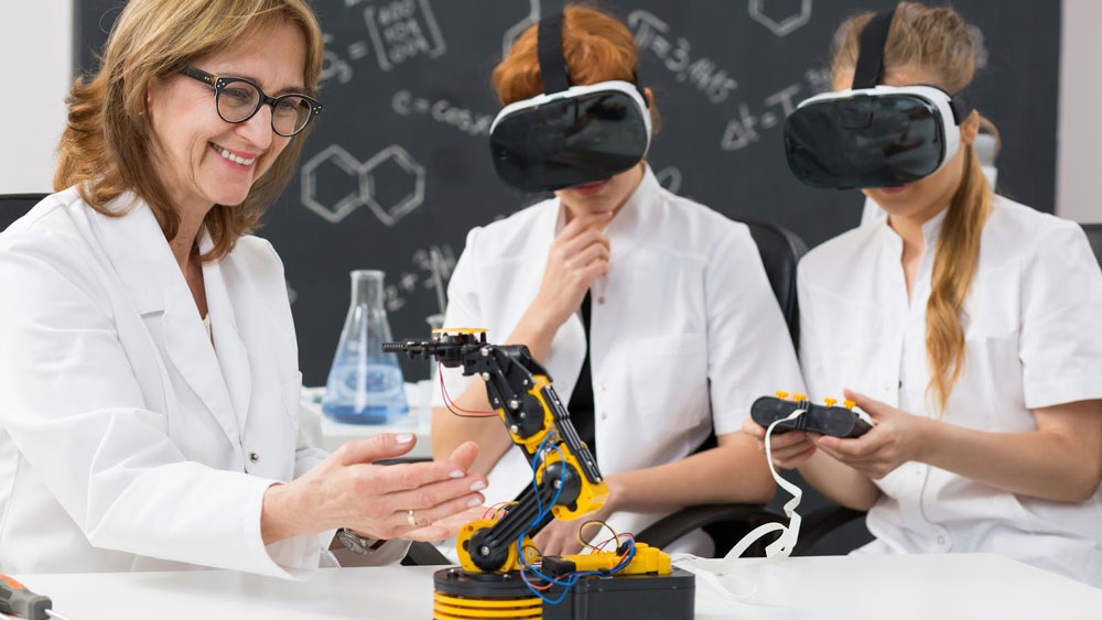 Teacher guides students wearing VR goggles.