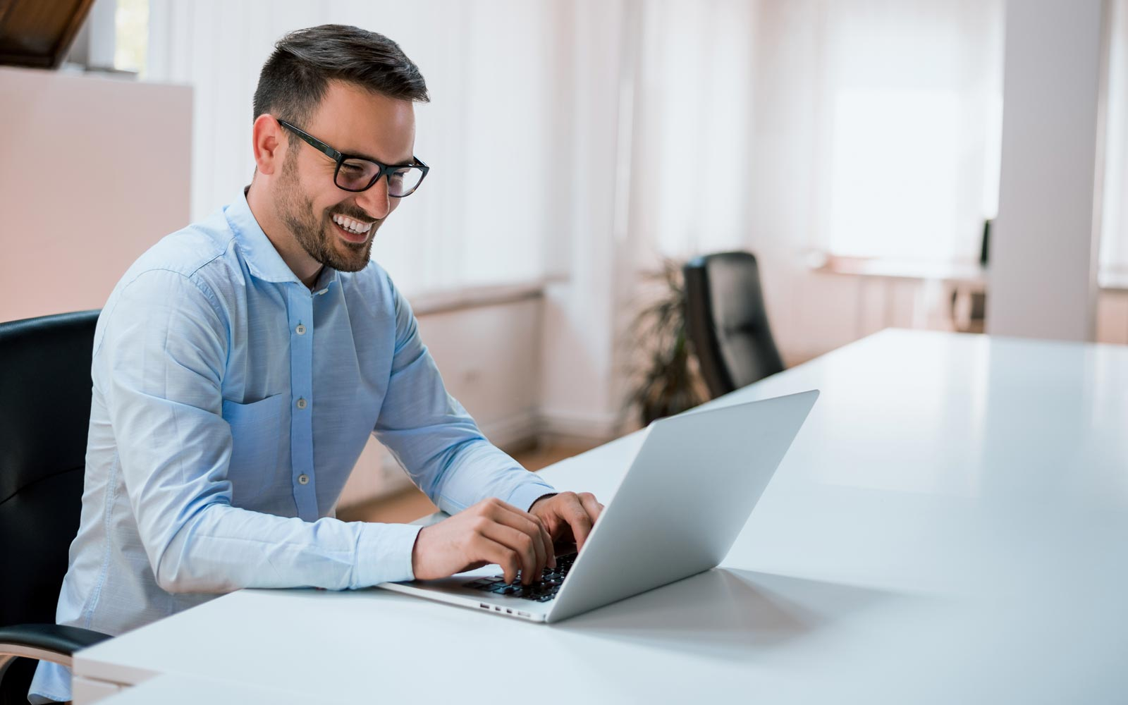 Facility manager working on his laptop