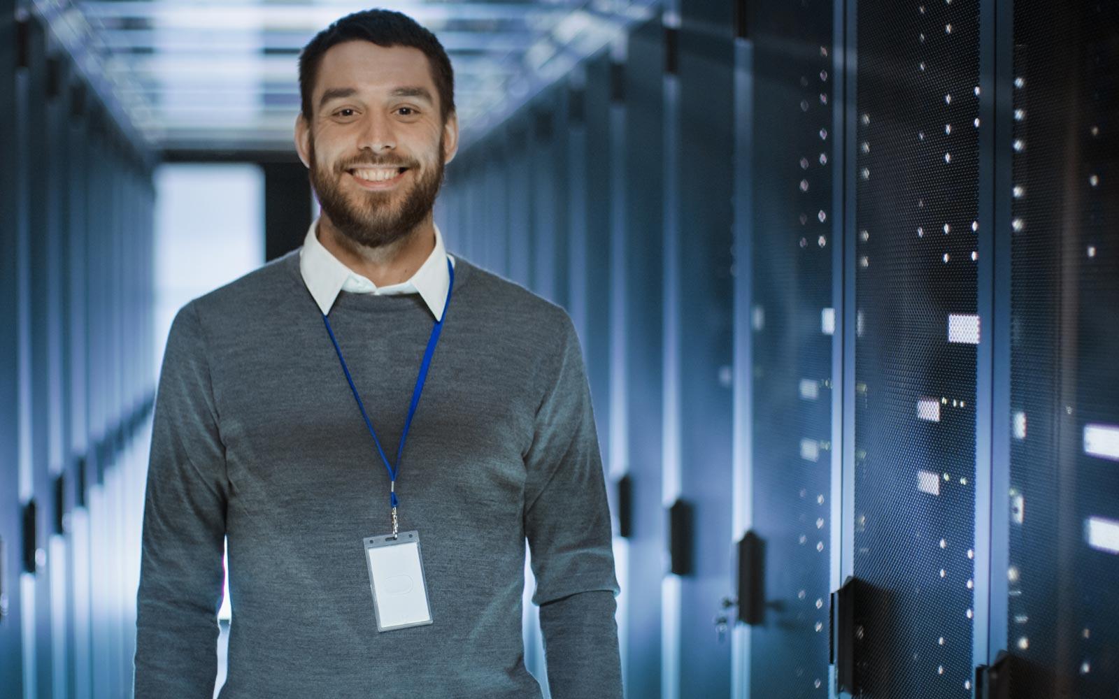 Cloud technician standing in server room