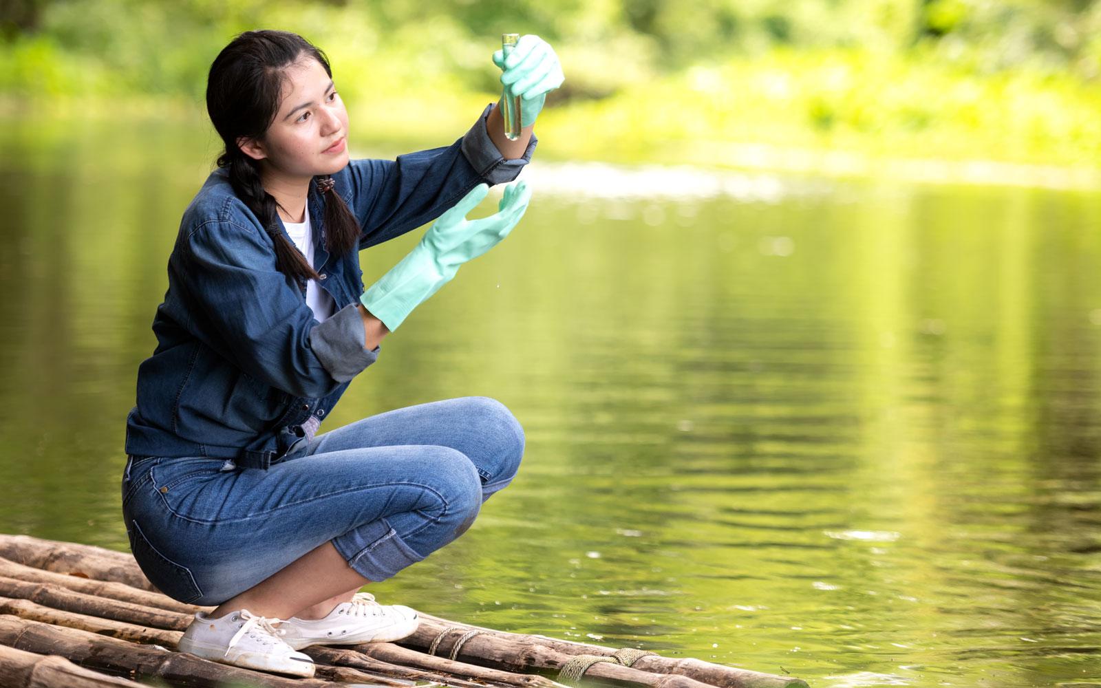 Environmental scientist taking water samples