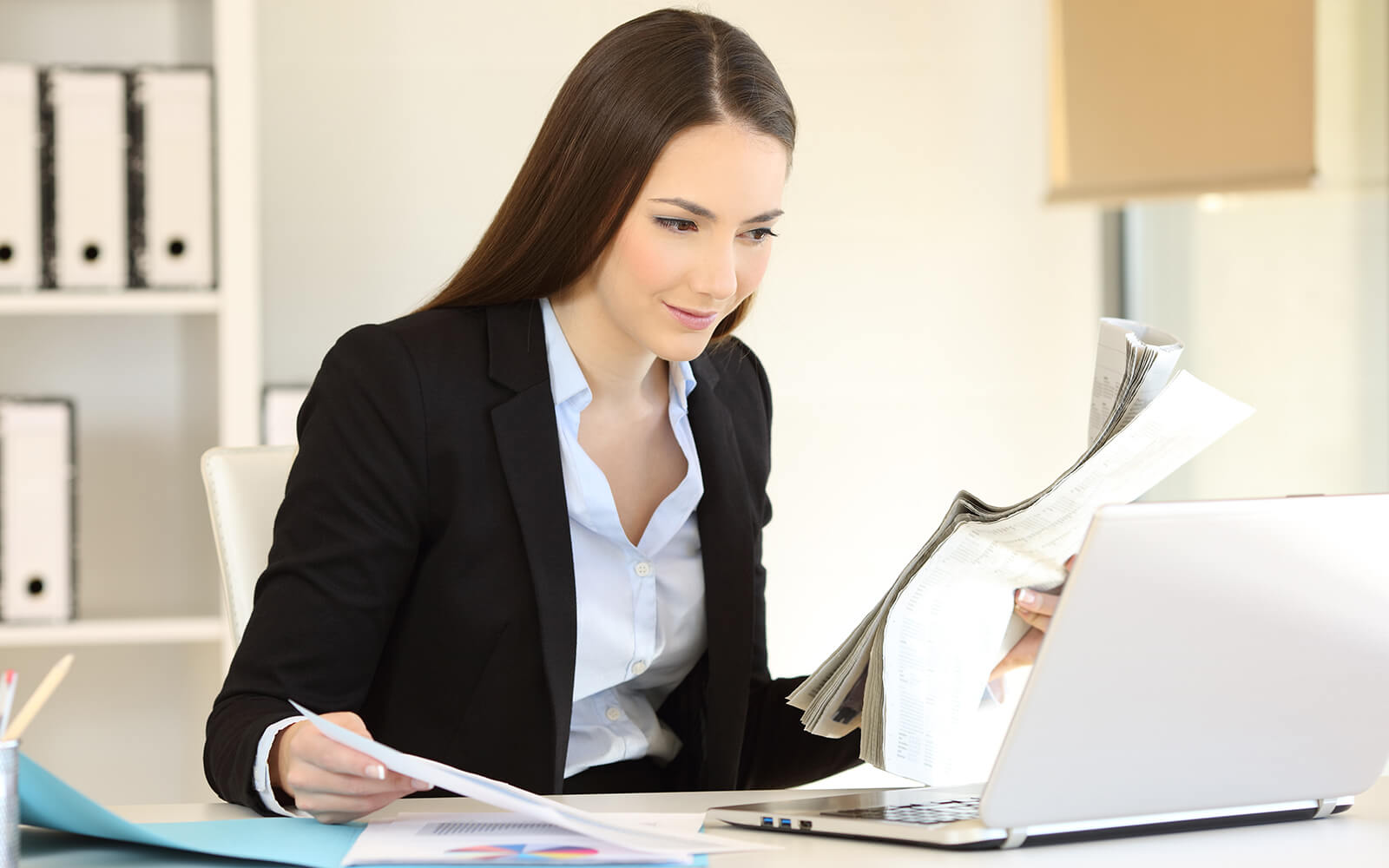 A female looking at paper