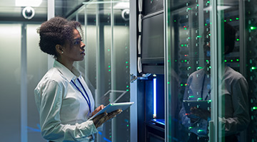 AWS engineer looking at servers