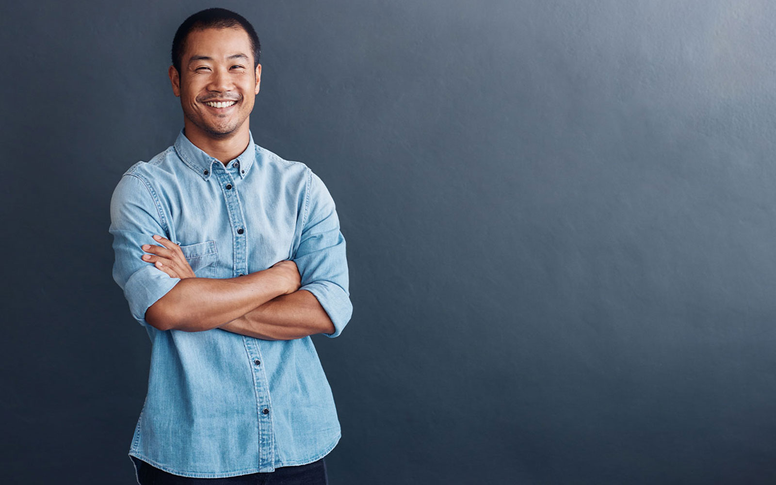 Digital Marketer with arms crossed smiling