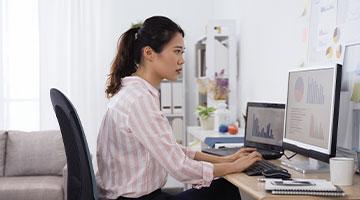 Data analyst working at her computer