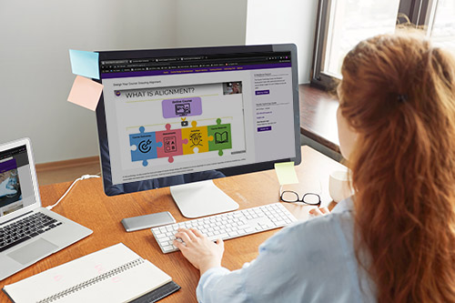 Woman viewing the Course Design & Development Training webpage