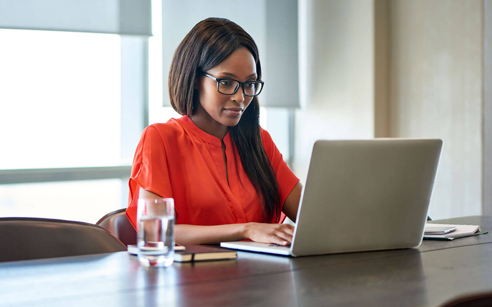 Woman working on her laptop at desk