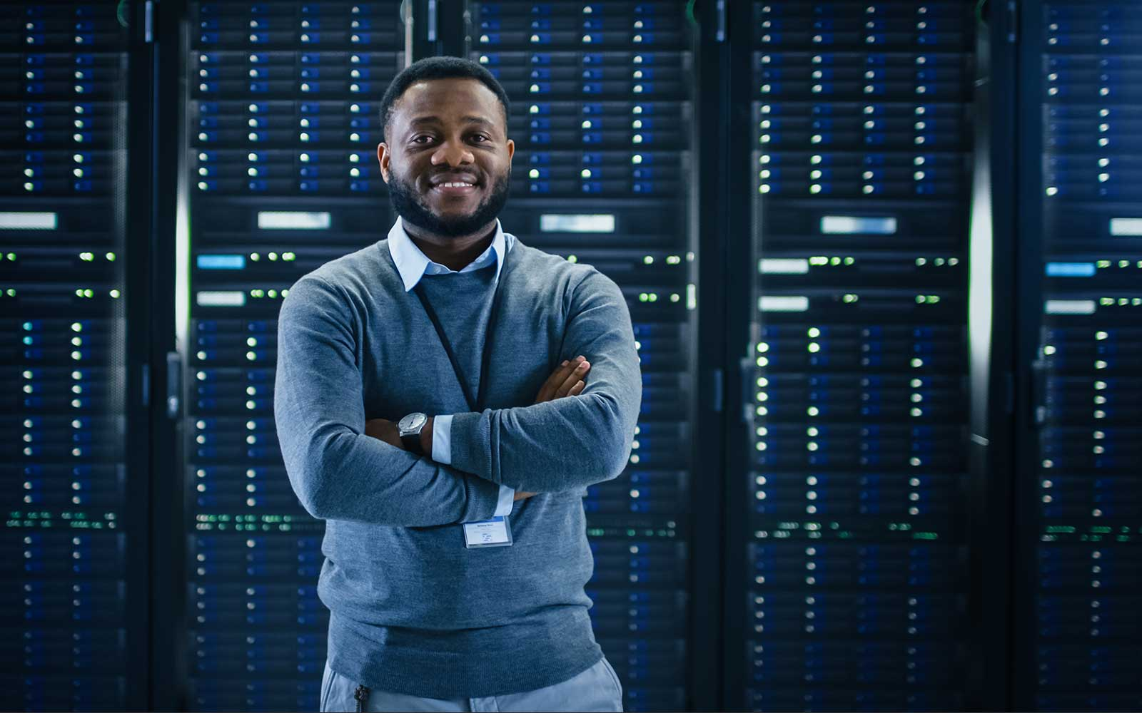 AWS Architect standing in front of servers