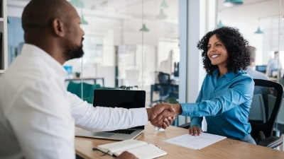 Male Human Resources Specialist Shaking Hands With Female Employee | Small Version