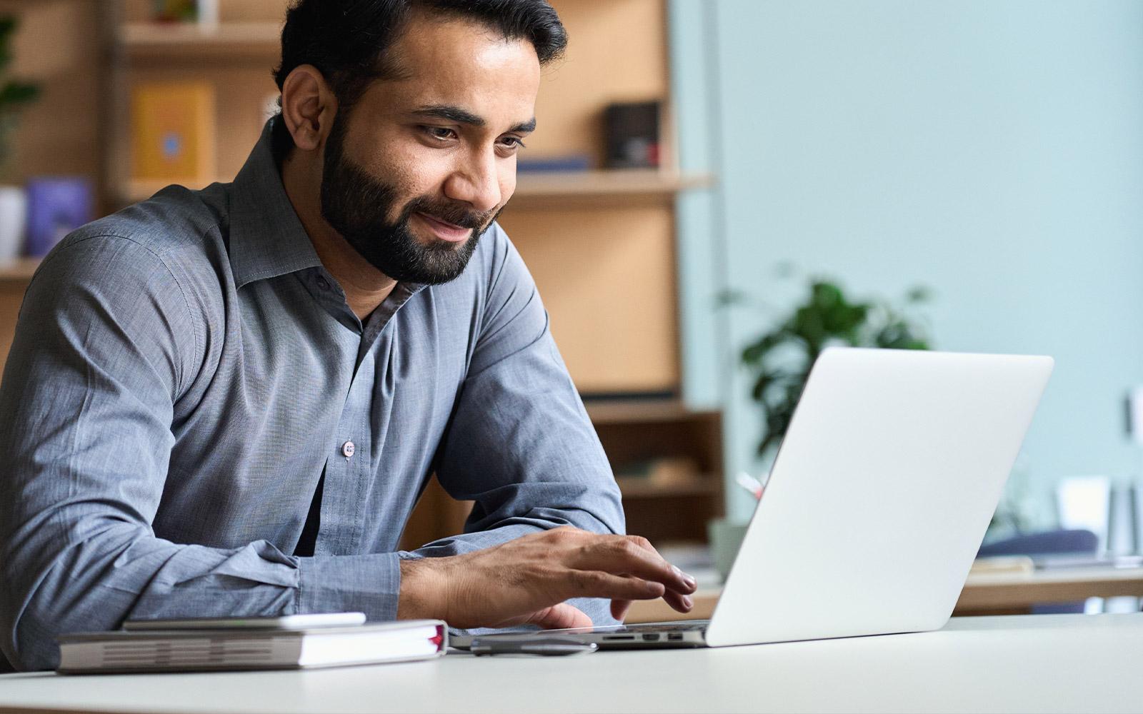 Man scrolling on his laptop