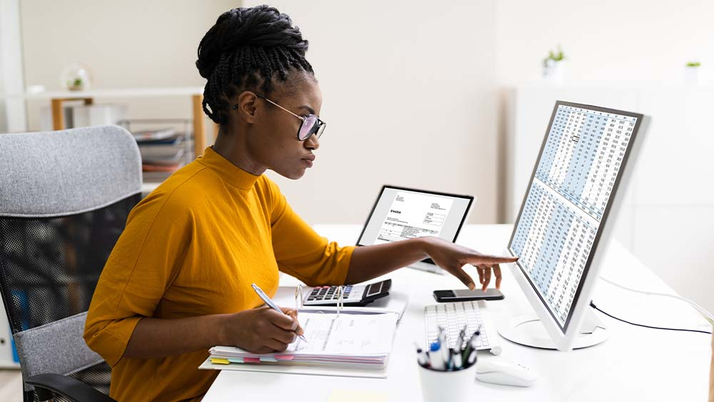 Woman CPA working on accounting for client