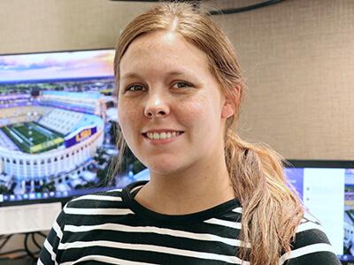 Kara McCoy at her desk