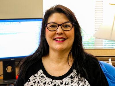 Lisa Lindsay at her desk