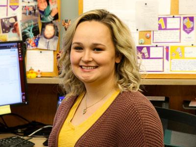 Michaela Hebert at her desk