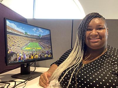 Raven Nichols at her desk