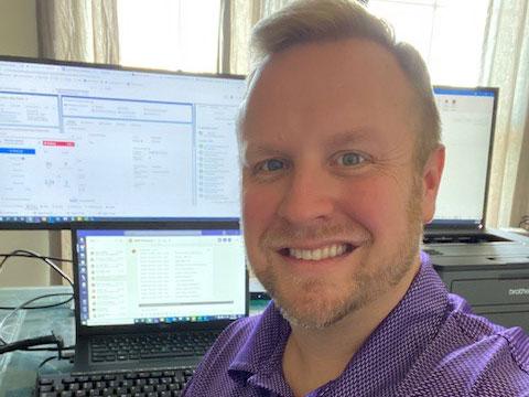 Michael Mason at his desk